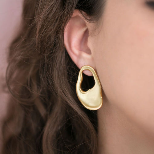 Large gold earrings in organic shape