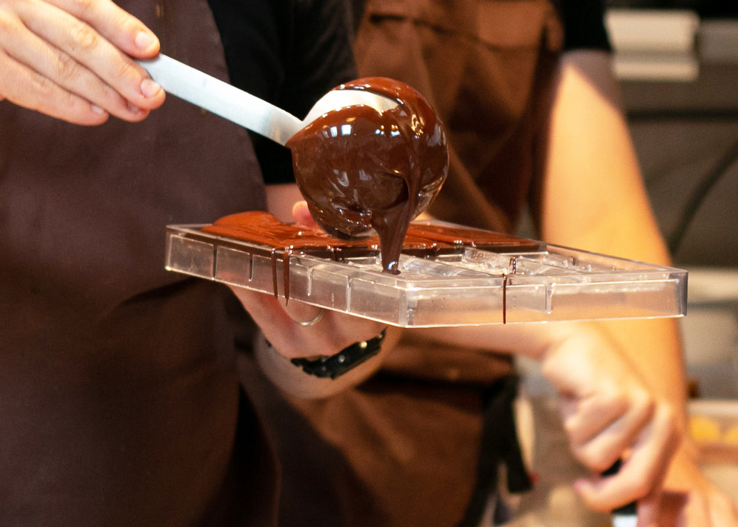 Chocolate bars poured into moulds