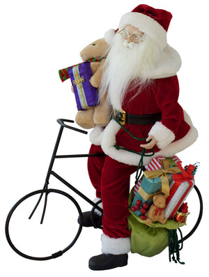 Santa resting on his bike