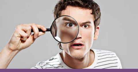 Male Teacher using a magnifying glass