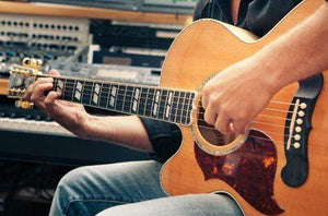 learn to play left-handed guitar