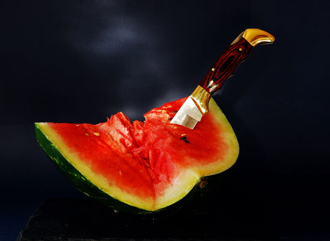 Fresh Watermelon stabbed with a Pocket knife
