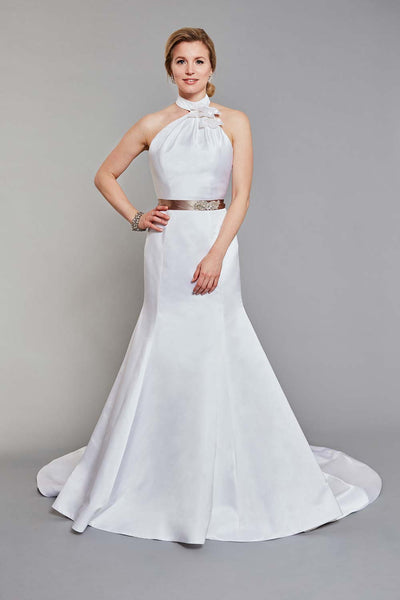 Bride wearing soft pleated halter neckline with floral detail and fitted trumpet skirt wedding dress