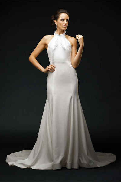 Bride wearing silk crepe halter wedding dress with chantilly lace insert at waist seam.