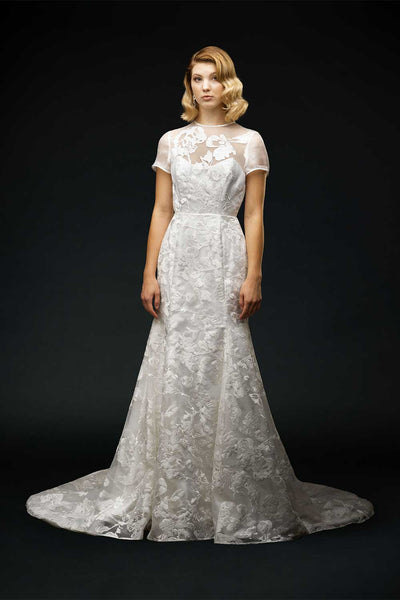 Bride wearing lace wedding dress with sleeves