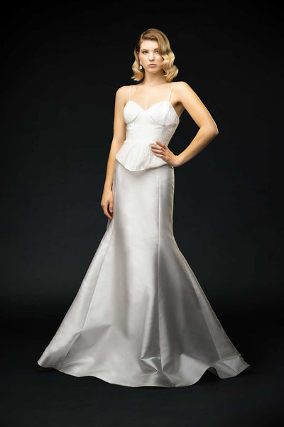 Silk mikado skirt with puddle train and jacquard swiss dot fitted peplum bodice wedding gown