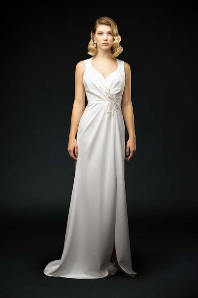 Silk crepe sheath dress with pleated and feather embroidery detail. Sexy slit and low-cut exposed back wedding gown front view