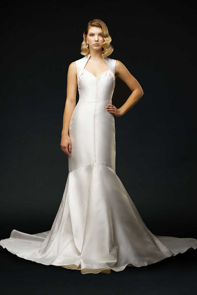 Bride wearing silk mikado covered shoulder wedding gown, with soft pink neckline