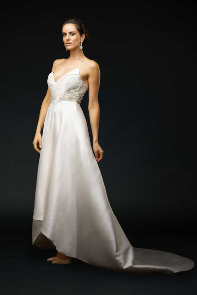 Bride wearing strapless wedding gown with contrast neckline and striking Swarovski crystal beading at waist.