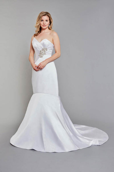 Bride wearing fitted sweetheart bodice, beaded with striking Swarovski crystals wedding gown