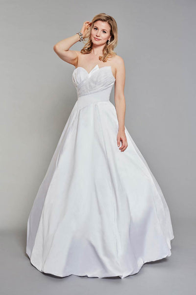Bride wearing strapless wedding dress with beautiful pleated detail on both the front and back of the gown.
