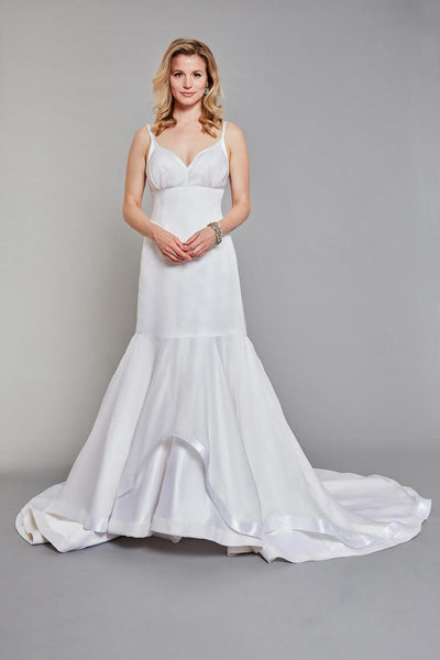 Bride wearing fitted, low-cut, empire-waisted gown with delicate straps and a soft gathered bodice overlay. silk wedding dress