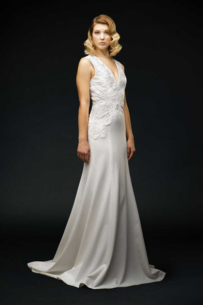 Silk crepe, asymmetrical embroidered bodice with fitted trumpet skirt and puddle train wedding gown