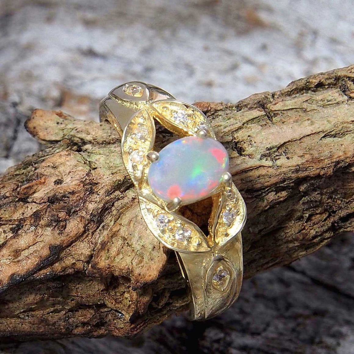 Gold plated sterling silver ornate design ring claw set with a beautiful South Australian multi-colour oval solid white opal and ten cubic zirconias