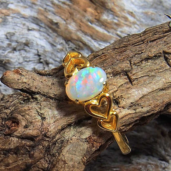 Pretty heart design gold plated sterling silver ring claw set with a beautiful multi-colour South Australian oval solid crystal opal