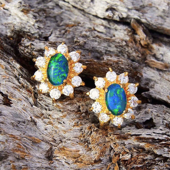 Dazzling princess design gold plated sterling silver stud earrings each claw set with green and blue oval triplet opals surrounded by 10 diamantes