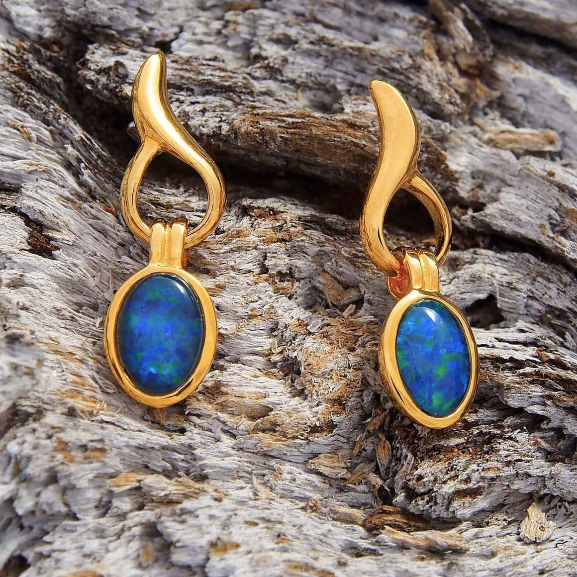 Gold plated sterling silver flame design drop-style stud earrings bezel set with blue and green oval triplet opals