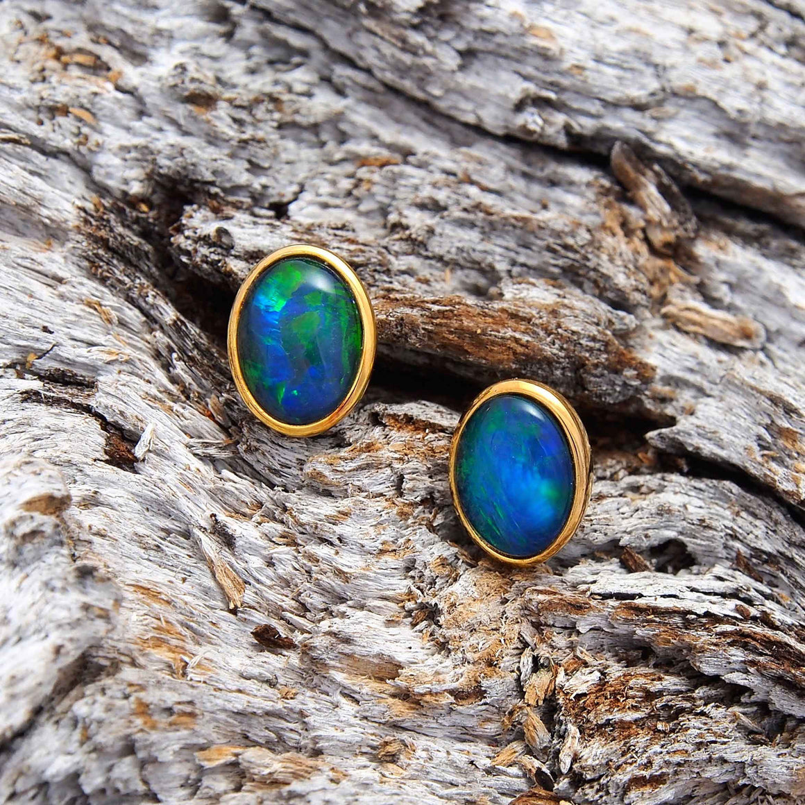 Classic gold plated sterling silver oval stud earrings bezel set with blue and green triplet opals