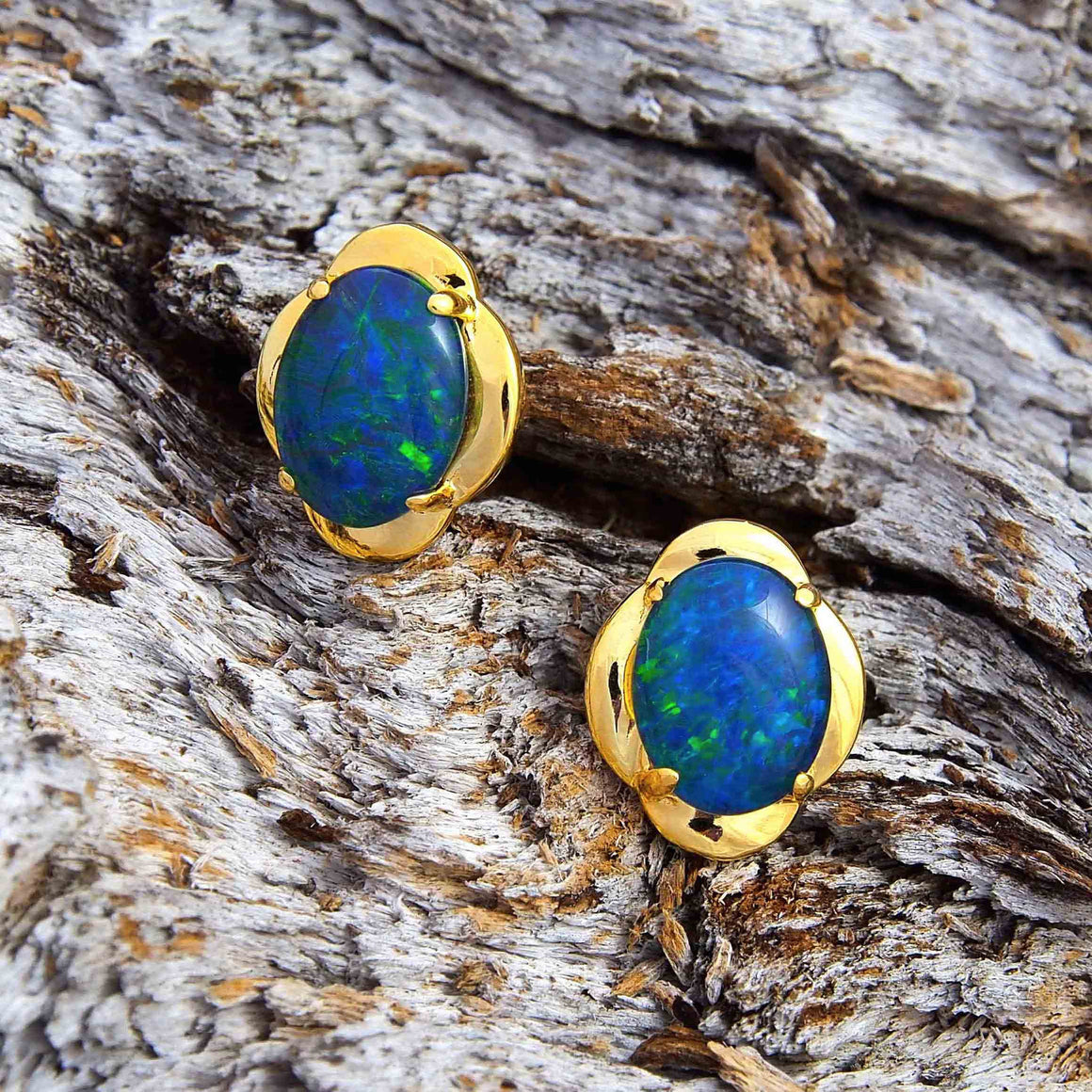 Stylish gold plated sterling silver scallop design stud earrings claw set with blue and green oval triplet opals