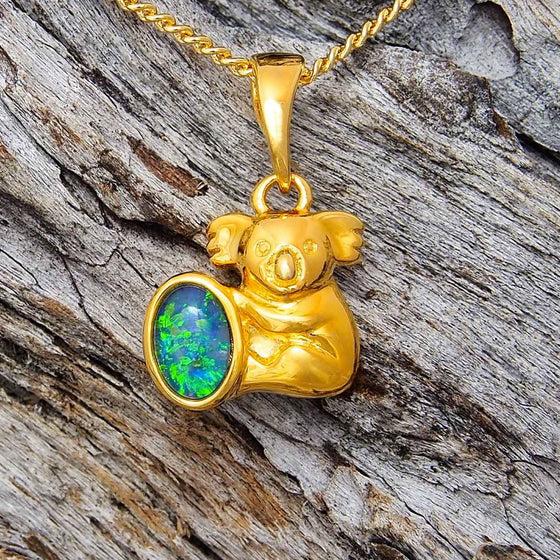Gold plated sterling silver koala design necklace pendant bezel set with a green and blue oval triplet opal