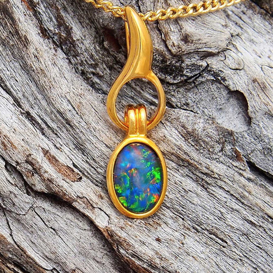 Gold plated sterling silver flame design drop style necklace pendant bezel set with a colourful oval triplet opal