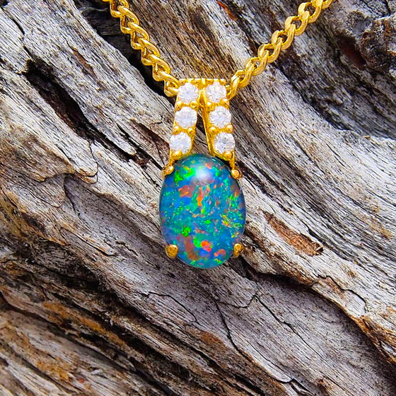 Pretty gold plated sterling silver necklace pendant claw set with a colourful oval triplet opal and six cubic zirconias
