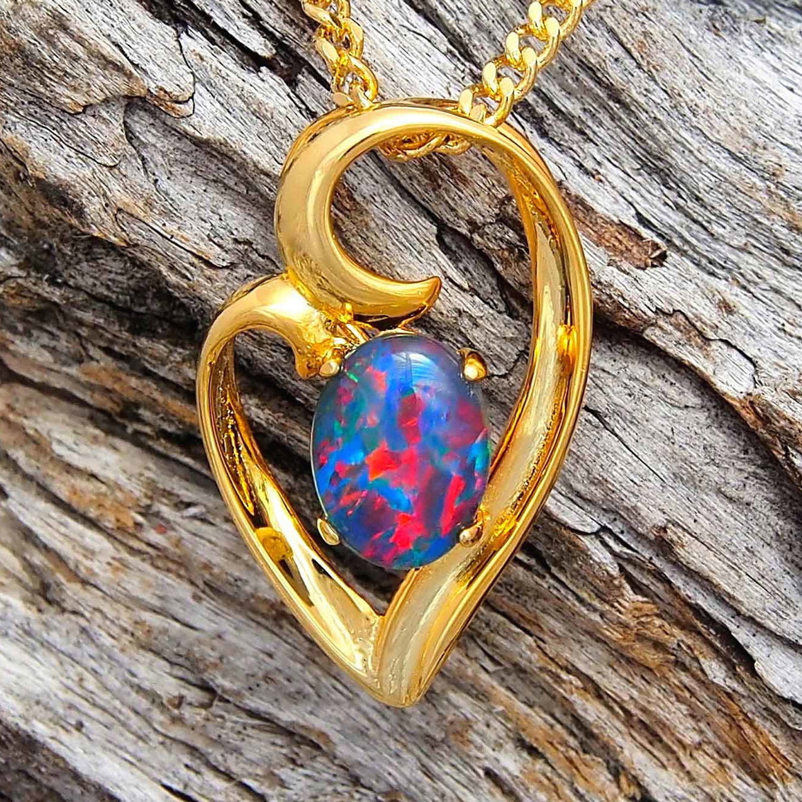 Elegant gold plated sterling silver decorative design slide necklace pendant claw set with a red, blue and green oval triplet opal