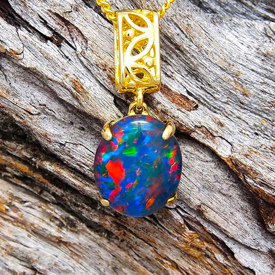 Gold plated sterling silver filigree barrel drop-style necklace pendant claw set with a colourful oval triplet opal
