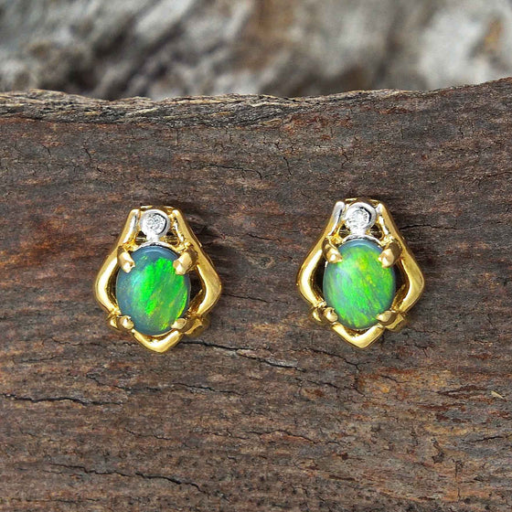 Attractive 18ct yellow gold stud earrings each claw set with a brilliant green and yellow oval Lightning Ridge solid black opal and a round diamond