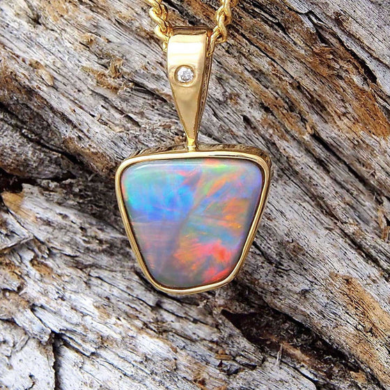 Handcrafted 18ct yellow gold unique necklace pendant bezel set with a multi-coloured freeform-shape Lightning Ridge solid light opal and a white diamond