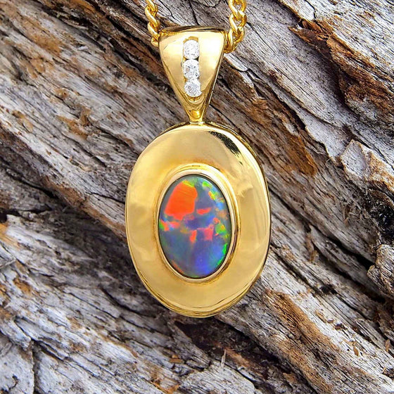 Handcrafted 18ct yellow gold oval necklace pendant bezel set with a multi-colour Lightning Ridge solid black opal and three white diamonds