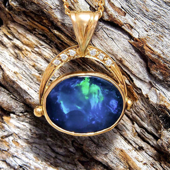 18ct yellow gold drop-style swing necklace pendant bezel side-set with a blue and green broad flash patterned oval Lightning Ridge solid black opal and six white diamonds