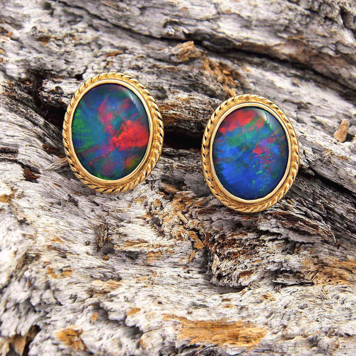 Vintage style 9ct yellow gold oval stud earrings bezel set with rich red, blue and green triplet opals