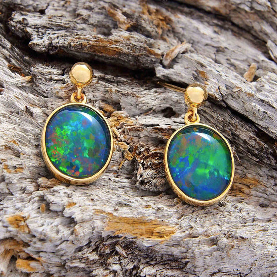 Elegant 9ct yellow gold drop-style oval stud earrings bezel set with green, blue and red floral patterned triplet opals