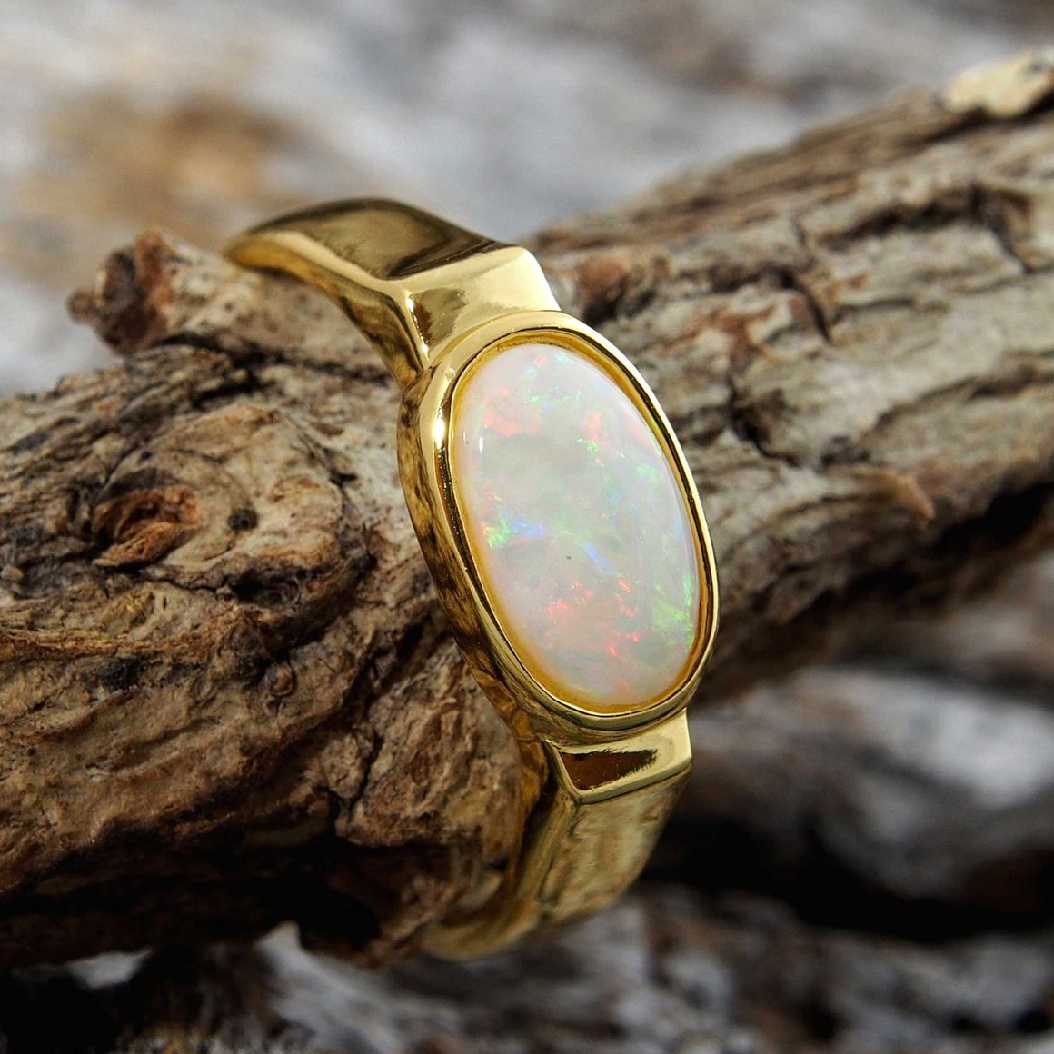 Gold plated sterling silver ring bezel set with a beautiful South Australian multi-colour oval solid white opal.