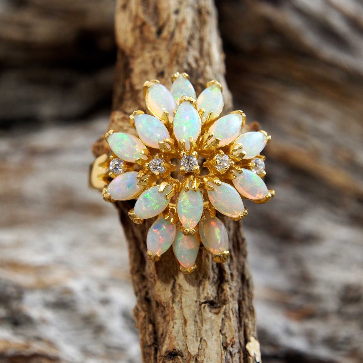 Gorgeous gold plated sterling silver dress ring claw set with 16 beautiful South Australian multi-colour marquise cut solid crystal opals.
