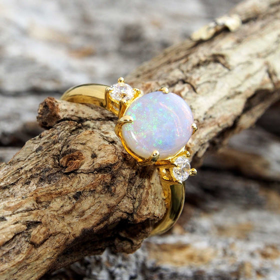 Elegant gold plated sterling silver ring claw set with a beautiful South Australian oval solid crystal opal and two shoulder set cubic zirconias.