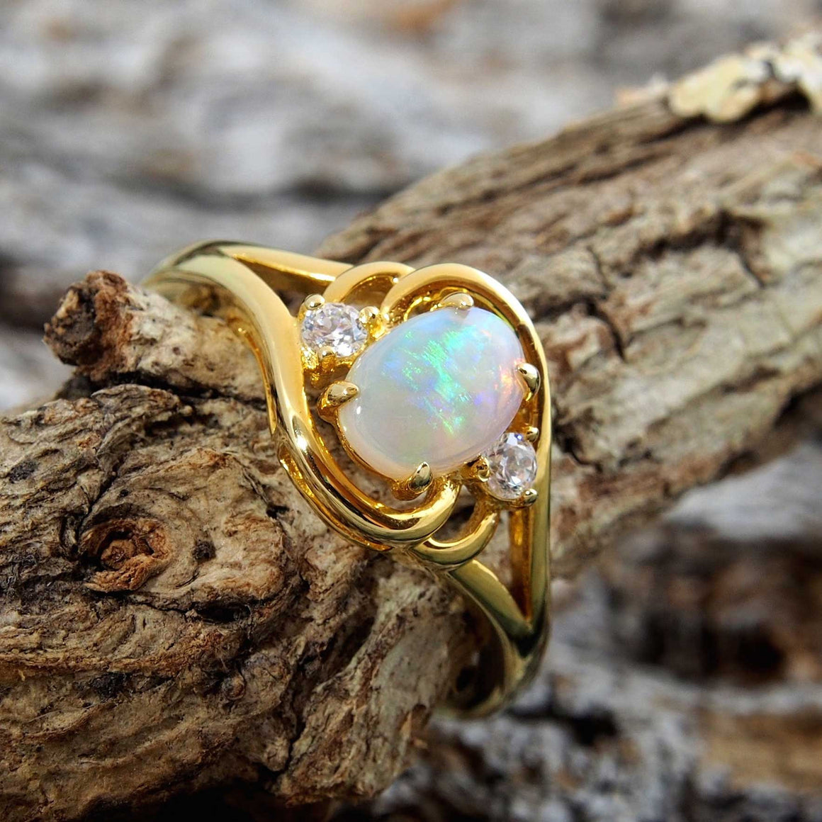 Gold plated sterling silver ring claw set with a beautiful green South Australian oval solid crystal opal.