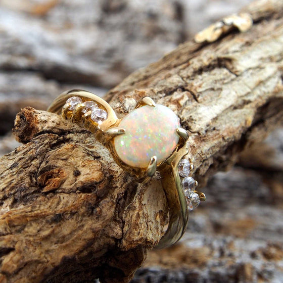 Gold plated sterling silver ring claw set with a beautiful South Australian oval solid crystal opal shoulder set with six cubic zirconia.