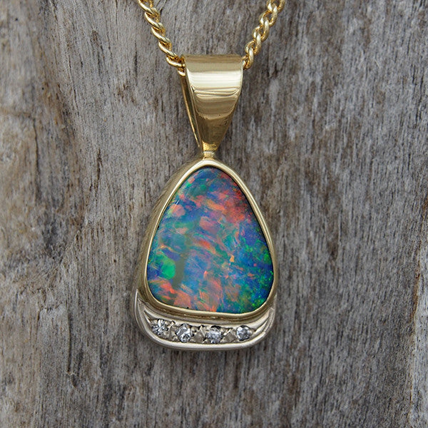 Stunning 18ct yellow gold necklace pendant bezel-set with a multi-colour Queensland solid boulder opal with 4 white diamonds