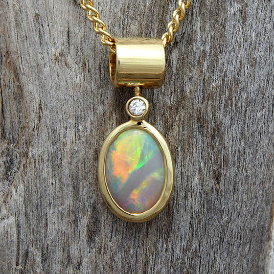 Stunning 18ct yellow gold necklace pendant bezel-set with a multi-colour South Australian solid crystal opal and one white diamond