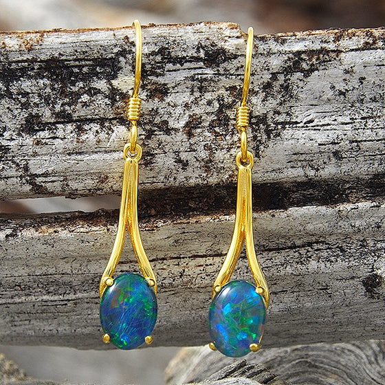 Gold plated sterling silver shepherd hook earrings claw set with blue and green oval triplet opals.