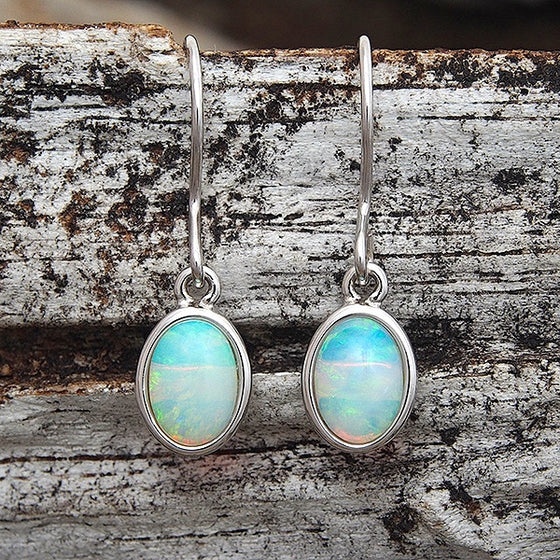 Sterling silver shepherd hook earrings bezel set with blue, green solid South Australian crystal opals.