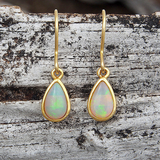 Gold plated sterling silver shepherd hook earrings bezel set with green solid South Australian crystal opals.