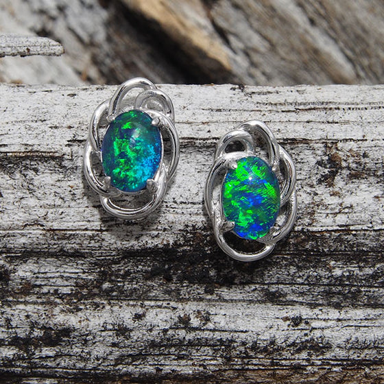 Sterling silver scallop design stud earrings claw set with green oval triplet opals.