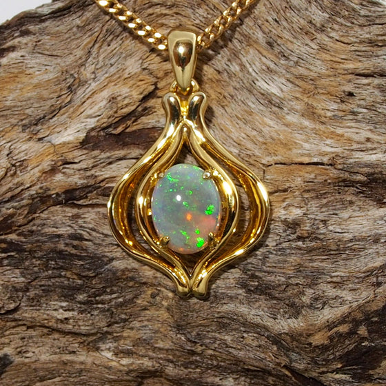 Uniquely designed necklace pendant claw set with a colourful oval shape crystal opal.