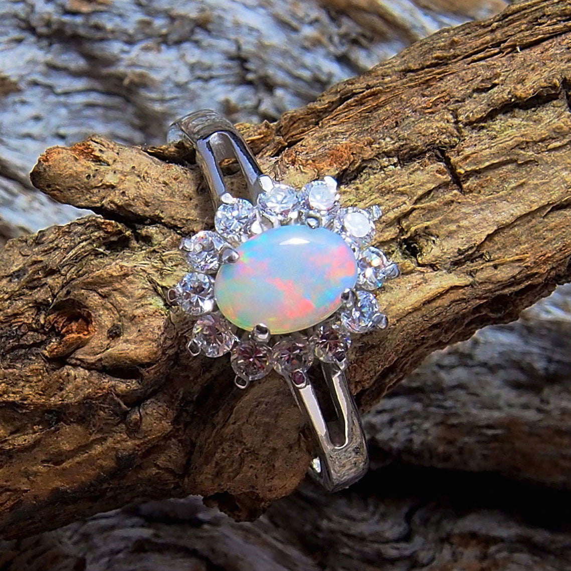 Pretty sterling silver princess design ring claw set with a beautiful multi-colour South Australian oval solid crystal opal and 12 cubic zirconias