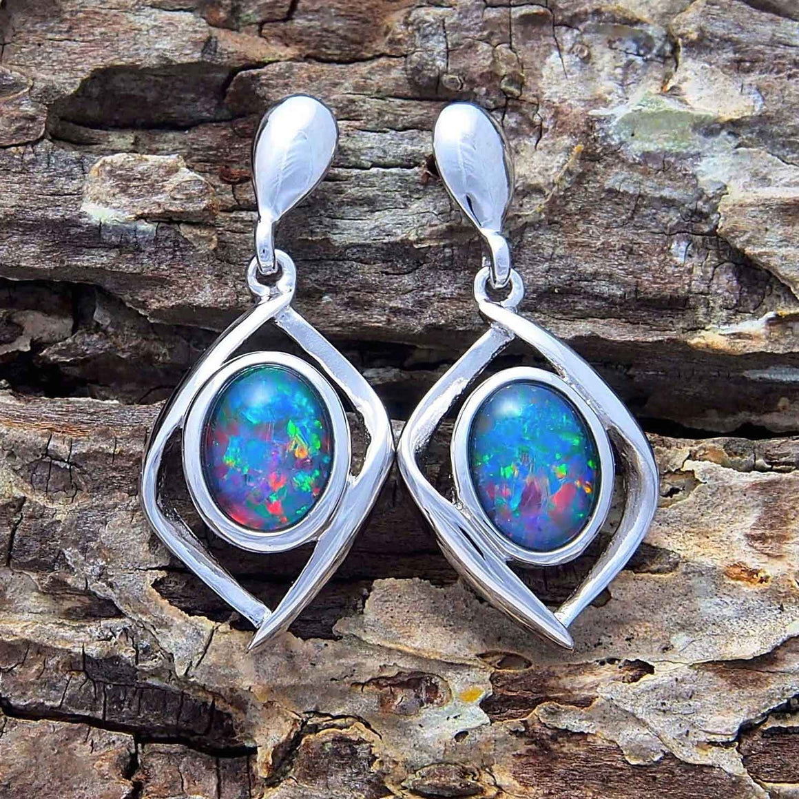 Sterling silver open cage design drop-style stud earrings bezel set with multi-coloured oval triplet opals