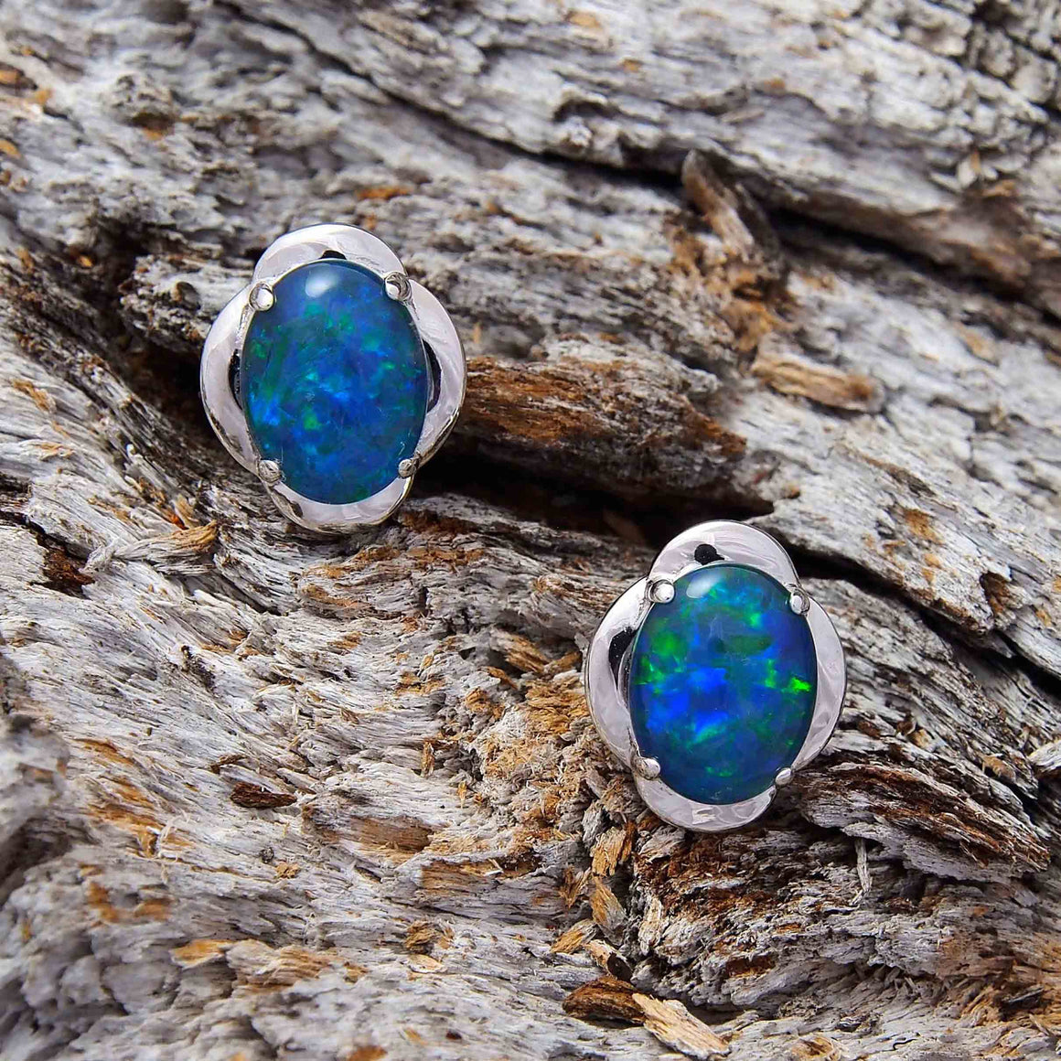 Sterling silver scallop design stud earrings claw set with blue and green oval triplet opals