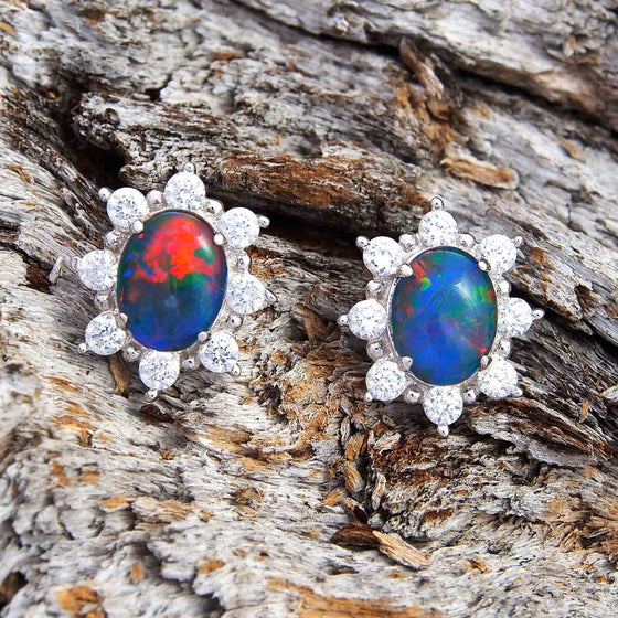 Dazzling princess design sterling silver oval stud earrings each claw set with multi-colour triplet opals surrounded by 10 diamantes